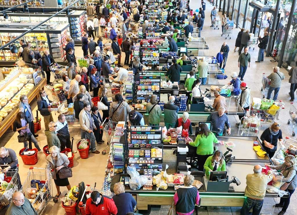 Overhead photo of a very busy supermarket: cashregisters and customers