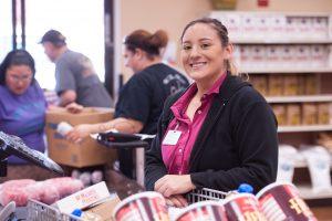 Supermarket cashier smiling