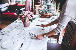 Woman setting dinner table