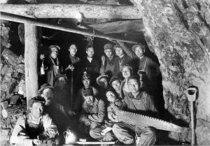 Men crowded into a mine