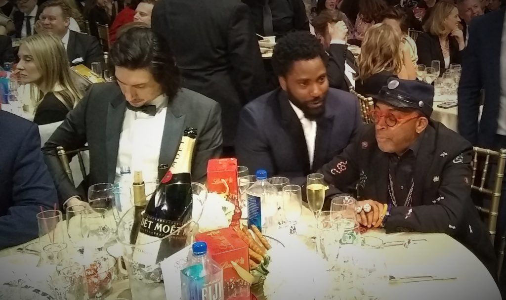 Photo of table of actors at an awards ceremony.