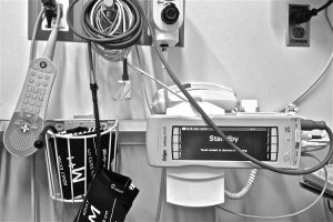 Photograph showing hospital room equipment.