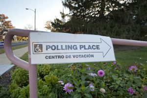 Photograph of a sign showing where a polling place is located.