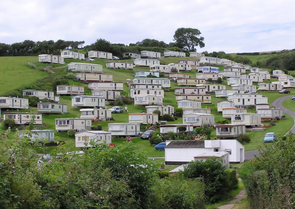 Photograph of hillside covered with mobile homes.