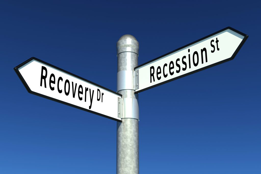 Two signs with the words Recovery Dr. on one and Recession St. on the