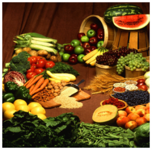 Photograph of table full of vegetables and fruits.