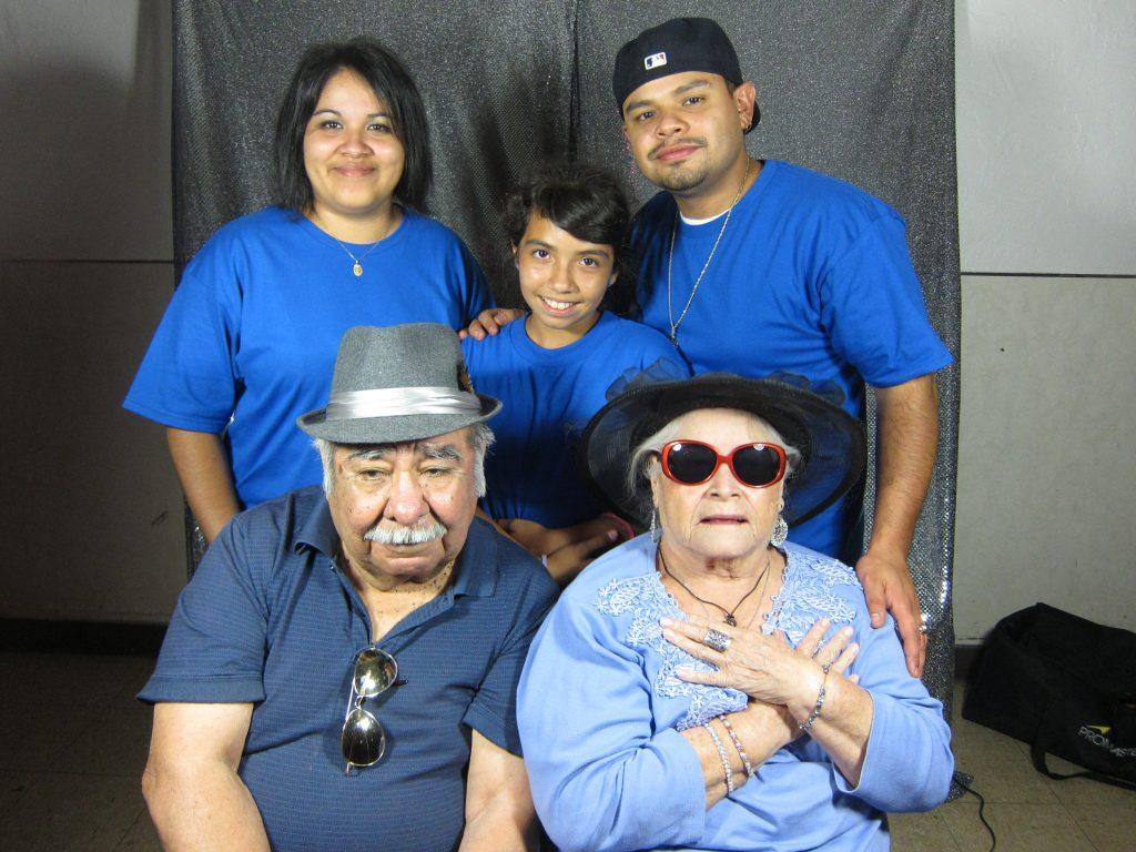 Five Hispanic people representing three generations.