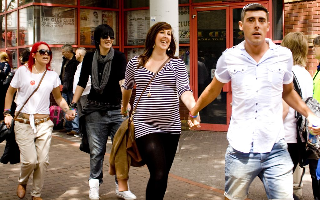 Four people in a line holding hands