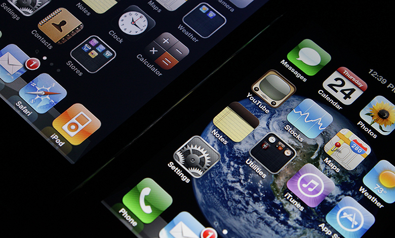 The image is a photograph of the iPhone's home screen.