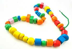 photo of different colors and shapes of beads on a string