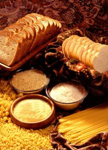 photo of bread, pasta, rice, and other carbohydrate-rich foods.