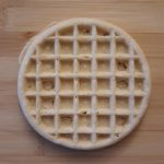 a circular waffle with a square grid pattern