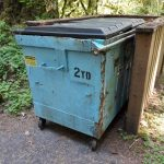 """a dumpster labeled """"2 yd"""""""