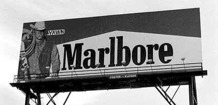 "Image of altered billboard, with ""Marlboro"" changed to ""Marlbore""."