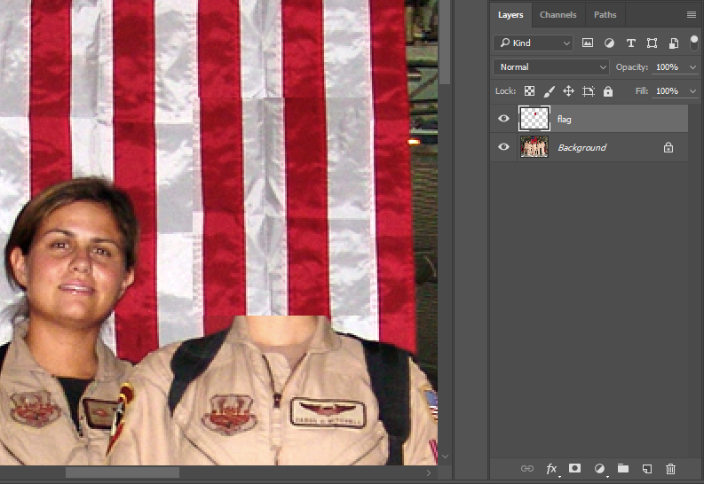 Image with section of flag copied over Capt. Mitchell's head.
