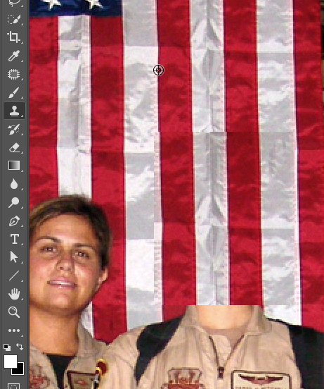 Using the clone stamp tool to touch up the duplicated flag stripes.