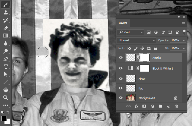 Screen capture showing a brush painting into the Amelia layer's layer mask to hide pixels.