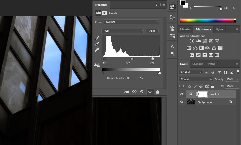 Photoshop® interface showing the Properties panel for a Levels adjustment layer added to the seagram building image.