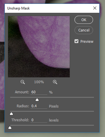 Screencapture of the Photoshop® Unsharp Mask filter controls, consisting of an image preview area with slider controls for Unsharp Amount, Radius, and Threshold.
