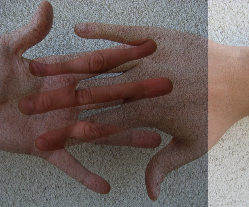 Composite image made from two photographs of hands, one is overlaying the other using the Photoshop® Multiply blend mode.