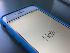 "a photo of an iPhone 6 with the word ""hello"" displayed at start up"