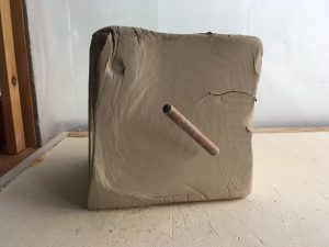 a large block of unsculpted pottery clay