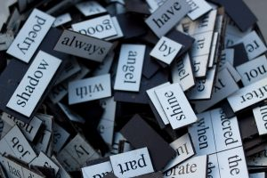 a photo of a pile of word magnets