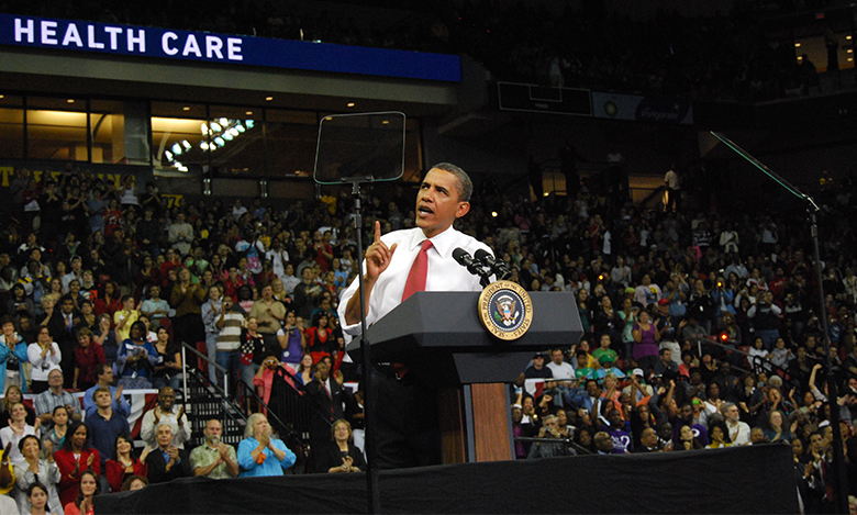 The picture is a photograph of President Barack Obama giving a speech on healthcare reform.