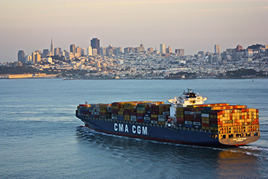 The image is a photograph of a cargo ship transporting goods.