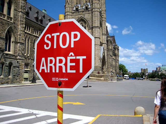 "Canadian stop sign reads ""stop"" and ""arret"""
