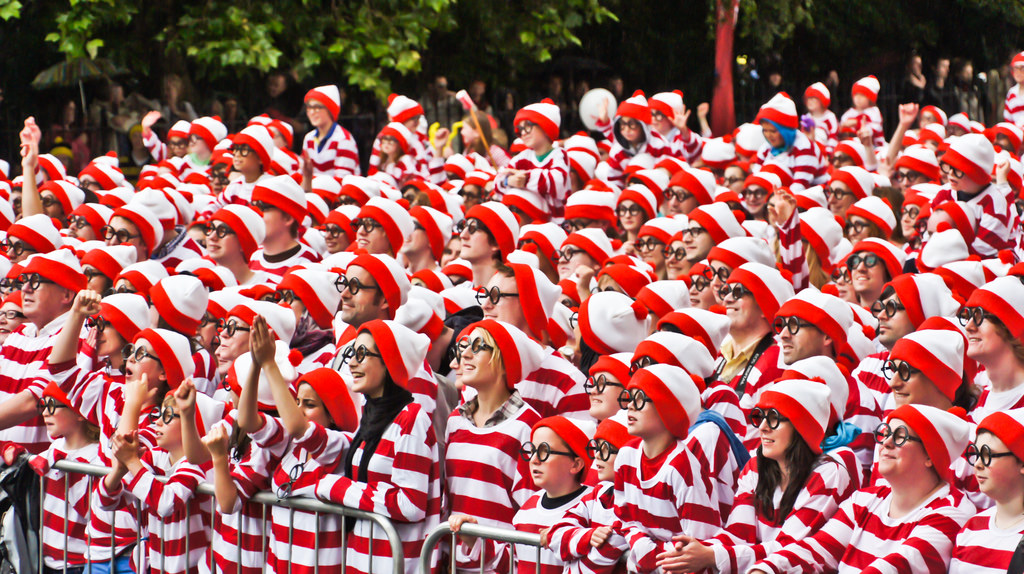 "crowd of people in identical ""where's waldo?"" costumes"