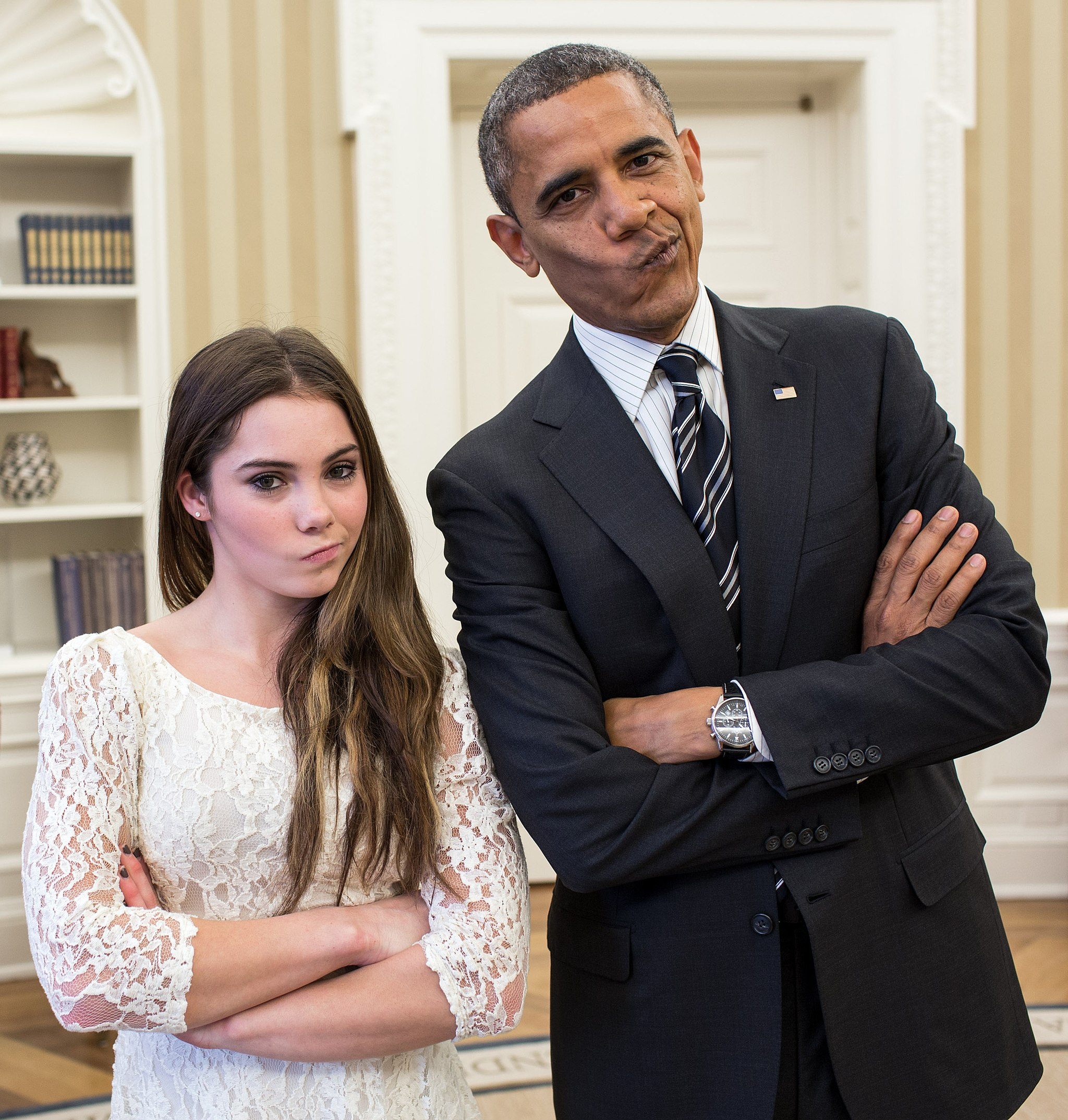 posed photo of intentionally smirking Barack Obama and USA gymnast McKayla Maroney illustrates visual drama and interest