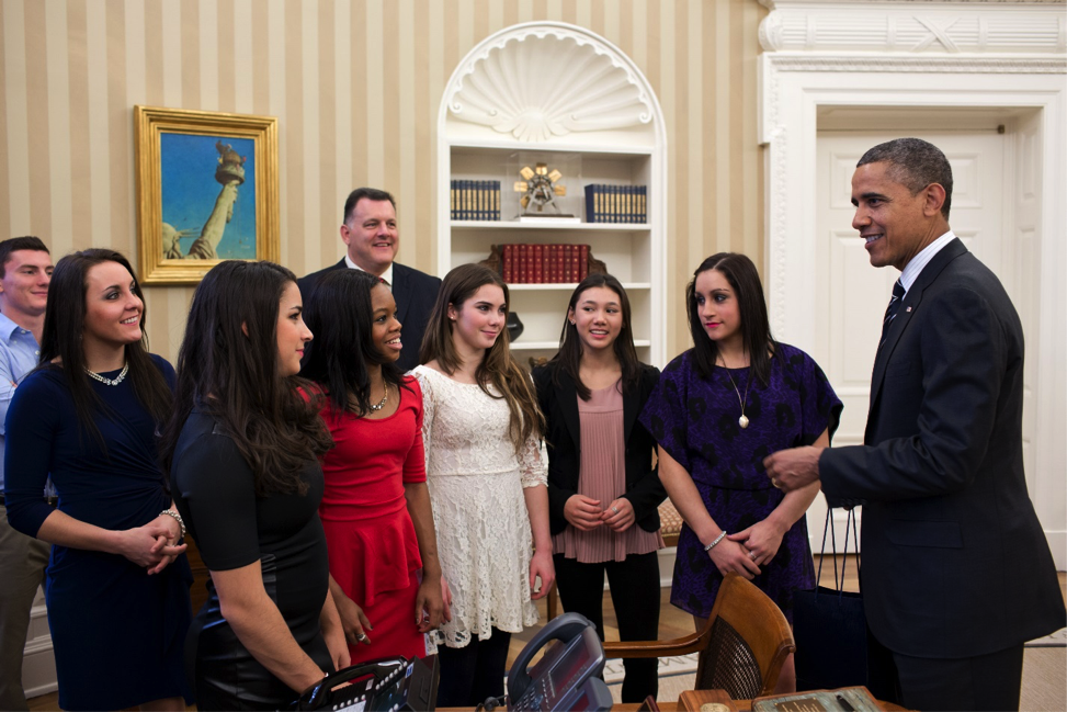 candid photo of Barack Obama, who is tall, and USA women's gymnasts, who are short, illustrates the concept of contrast