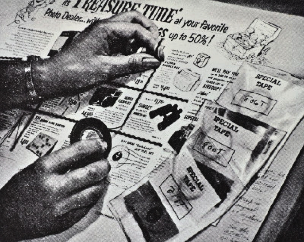 vintage photo of newspaper layout artist at work