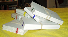 Piles of color-coded flashcards