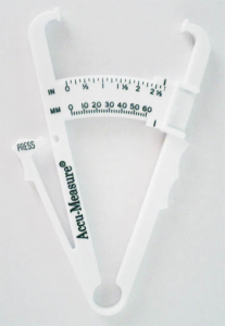 A pair of plastic rods connected by a hinge at one end, with pads on the open ends designed to pinch a fold of skin. A scale on the devise indicates the thickness of the pinched fold.