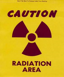 sign that says caution radiation area with radiation symbol