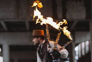 man with flaming bagpipes