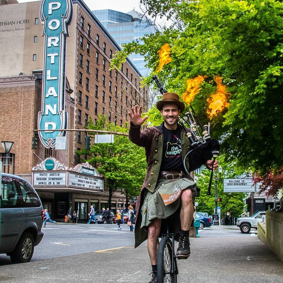 Brian riding unicycle in downtown Portland