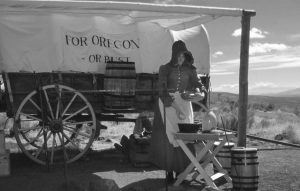 Pioneer woman with covered wagon