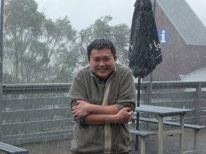 man outside in cold rain