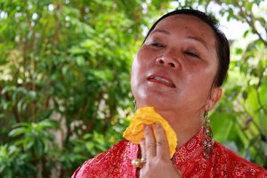 woman in hot weather, wiping her neck with a handkerchief