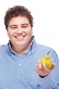 man offering a yellow pear