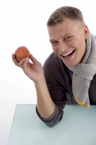 man offering a red apple