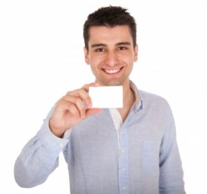 young man holding a piece of paper