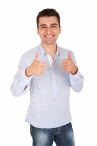 "man smiling and giving the ""thumbs up"" sign with both hands"