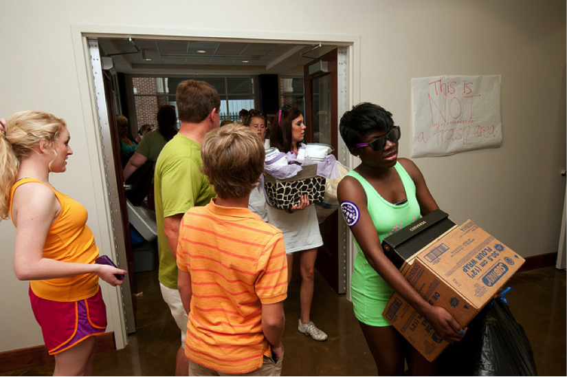 Students moving into a college dorm