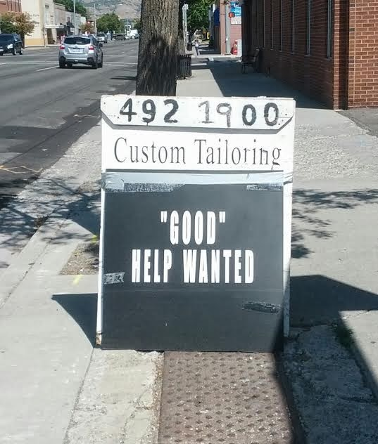 "Photo of a sign that reads ""Good help wanted."" The word good is incorrectly in quotation marks."