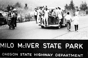 """Photo of young people on the hood of a slow moving car. Text below reads """"Milo McIver State Park"""""""