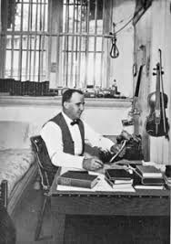 Photograph of Stephen Douglas Puter, sitting in front of a typewriter at a desk